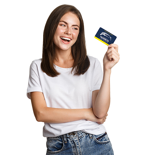 Attractive happy brunette girl laughing and holding credit card, white background